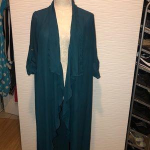 Long cardigan/blazer style. Thin material